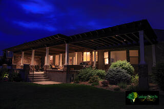Add intriguing features like uplighting or bistro lighting to your pergola.
